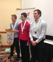 Cole Socha (center) is presented his medal