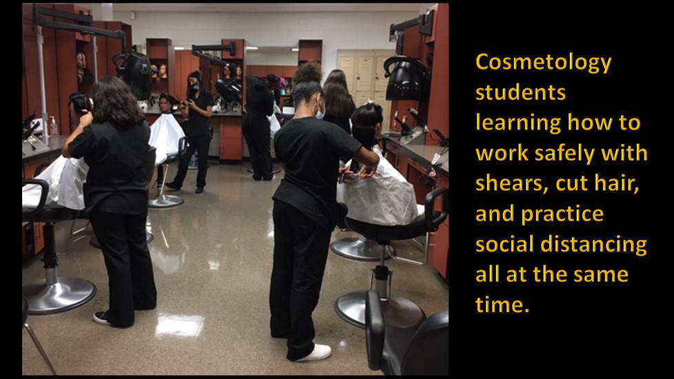 Cosmetology students working on manikins in the lab.