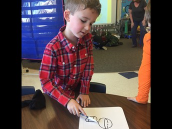 Nolan drawing 3D shapes in Kindergarten!