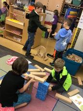 Third grade and kindergarten buddies working together.