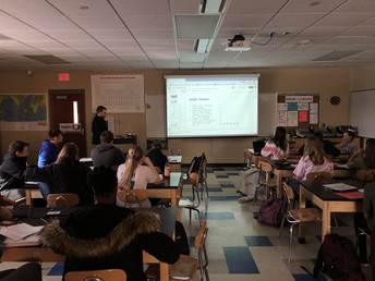 Mr. Clark leads learning in Physical Science class