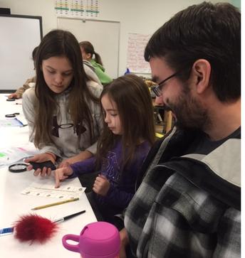 Middle Schooler, Ari, helps Mia and dad fingerprint!