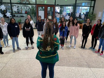 Choir Sings Holiday Music to Front Office