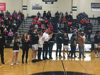 Boys Basketball and Winter Cheerleaders celebrate with their Parents.