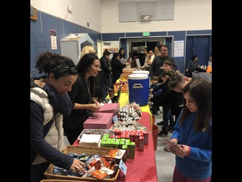 Unidos Volunteers Selling Snacks for Outdoor Ed. Thanks!!
