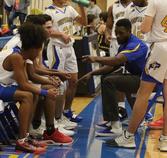 boys basketball gets guidance mid-game from coach pitts