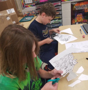 7th graders working on their gems and crystals in Art!