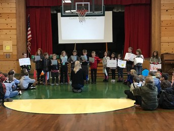Ms. Whalen's class providing a lesson at Monday Morning Meeting!