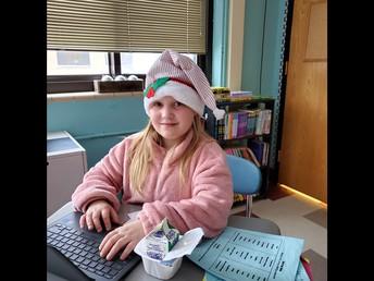 An elf working hard in ELA class.