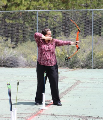 Mrs.Sheridan learning archery!