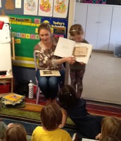 Danielle reading to the class.