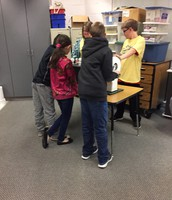 5th grade students sharing how much energy it takes to light different types of lightbulbs.