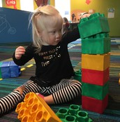 Everly stacking Legos
