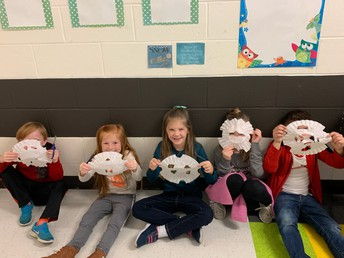picture of students holding snowflakes they made