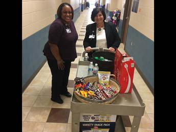 Dr. English and Ms. Smith deliver treats for teachers on the first day.