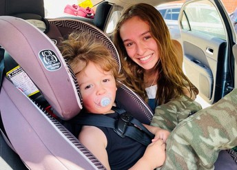 woman and child with car seat