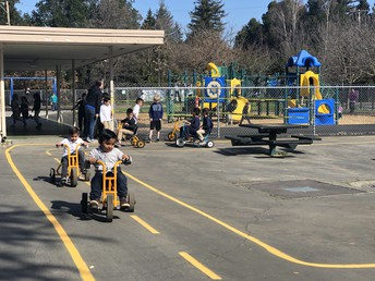 Kindergarten students riding on the new track!