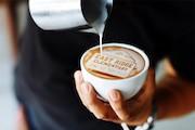 latte with East Ridge drawn in milk/foam