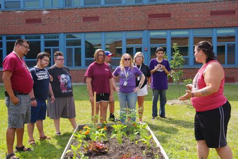 Isis Feliciano instructing students on the garden at HHS.