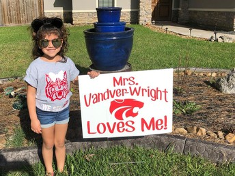Teachers delivered signs to their students!