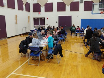 Parents and students at table during BINGO