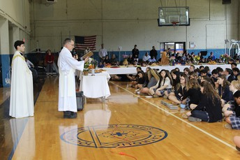 Saints Community Unites in Prayer at St. Joseph's Altar in Landry Gym