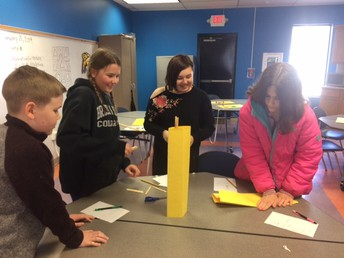 Students building towers to build teamwork.