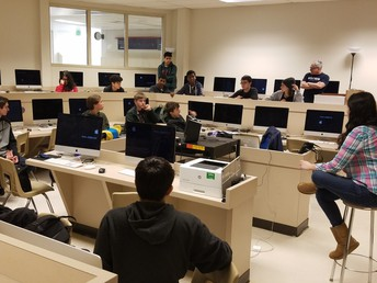 Former WHS student Nicole Kister speaks to Computer Science students