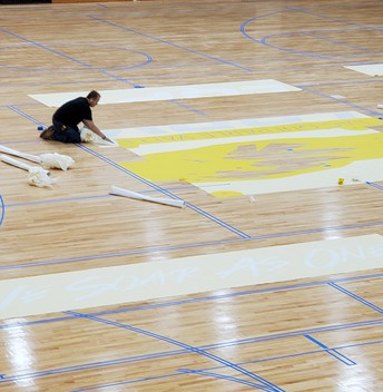 New logo being added to LQPV gym floor