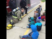 Firefighters talking with WLC's preschool students