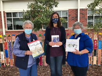 Daughters of the American Revolution donating books to Magnolia Library