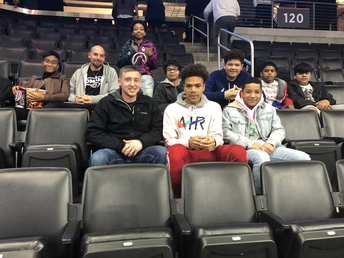 Coach Plank and Coach Langabee took their boys basketball team to a UNO game