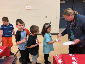 Mrs. Jackson Helping The Kids Make our Flag
