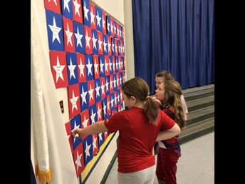 Looking at the Wall of Honor at Veterans Breakfast