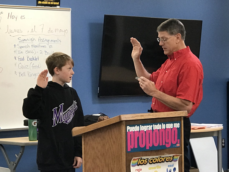 Student being sworn is as mayor