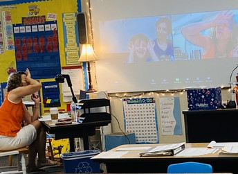"""Mrs. Emerson's 1st graders engrossed in a discussion of growth mindset , """"... when learning something new we must always keep trying."""""""
