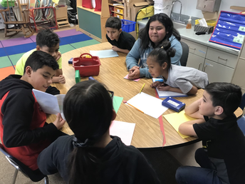 Ms. Wright's Dual Language students reading stories to students at Castelar