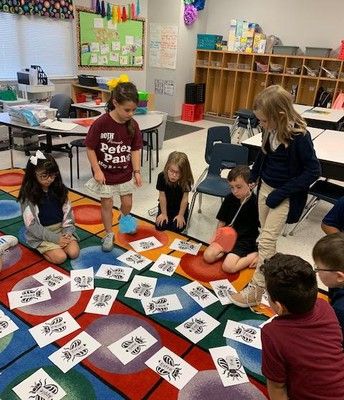 Students played a fly swatter game to review long vowels words with silent E!