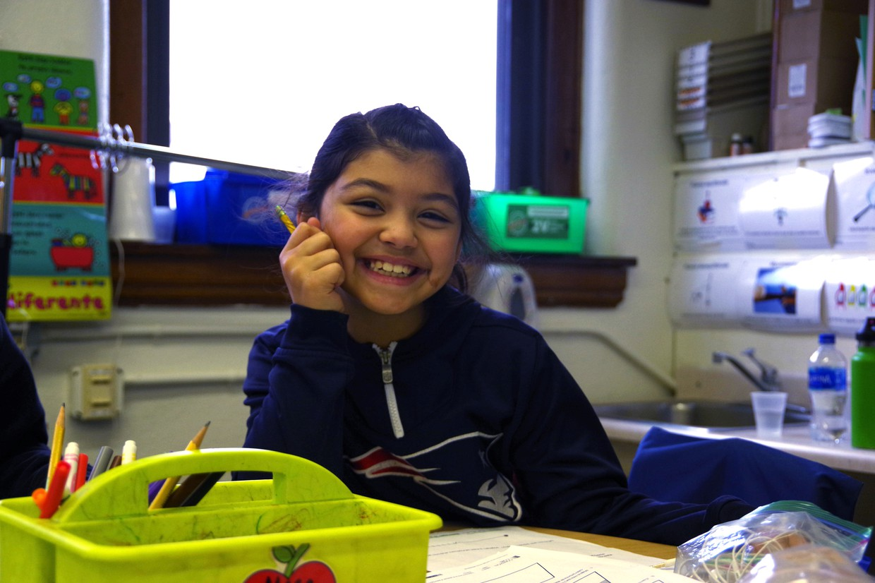 Girl engaged in school learning.