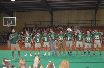 Captains backing up Coach T.J. Davis at Pep Rally