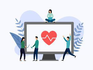 people relaxing and celebrating around a heart and a computer screen.