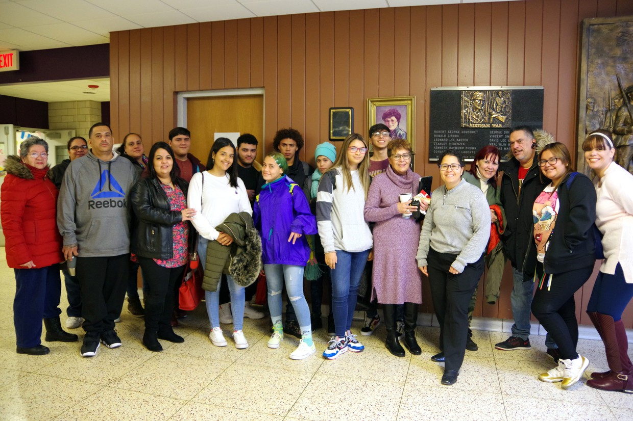 HHS welcomes newcomers - group of students and families standing in HHS North hallway