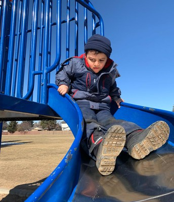 Pathways students enjoying the warm weather with playground time!