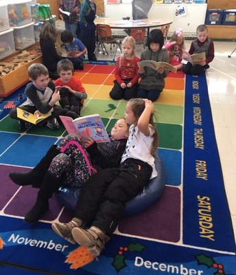 3rd graders reading with K students!  Love to see our students helping eachother!