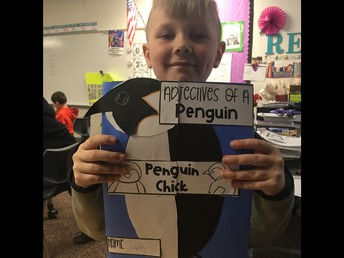 Cooper is proud of his Penguin Project!