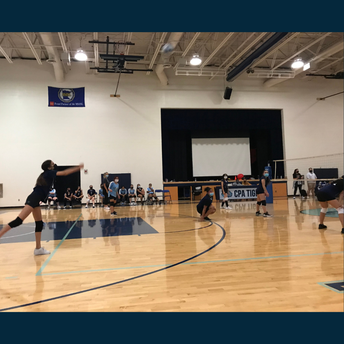 Action shot of the volleyball team playing a game.