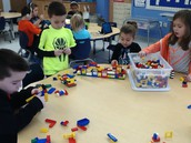 Group effort building buildings with Legos
