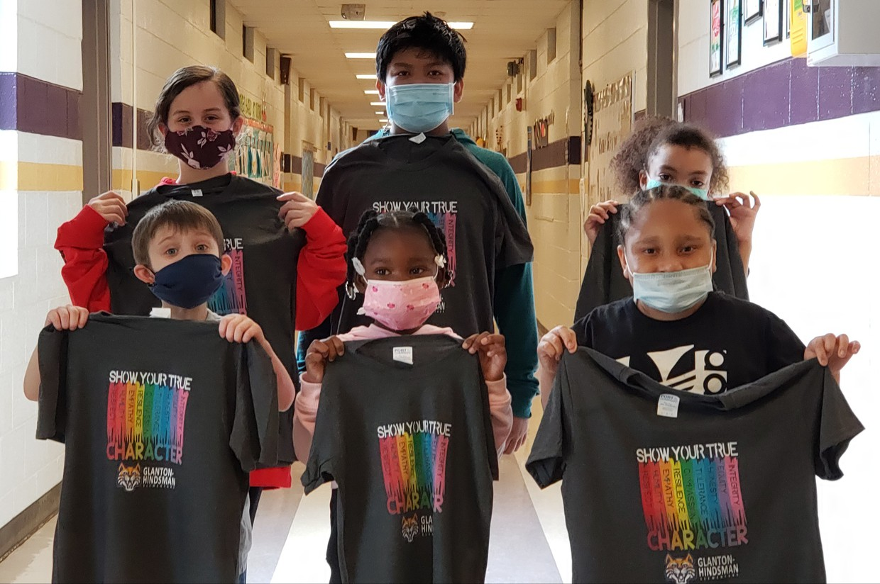 Students posing with character tshirts