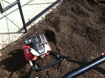 Tiller in soil.
