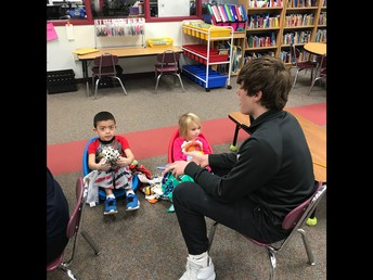 HS Students read with 5K & 1st Graders